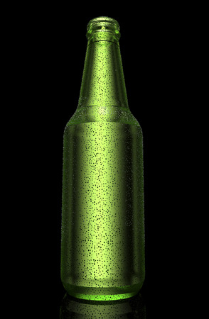 green beer bottle: drops on a cold green beer bottle.