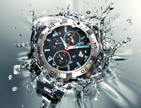 metal wristwatch is faling and splashing into clear water