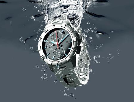 금속 손목 시계는 물을 받고있다.