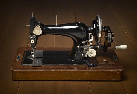 beautifull: beautifull sewing machine on a wooden background