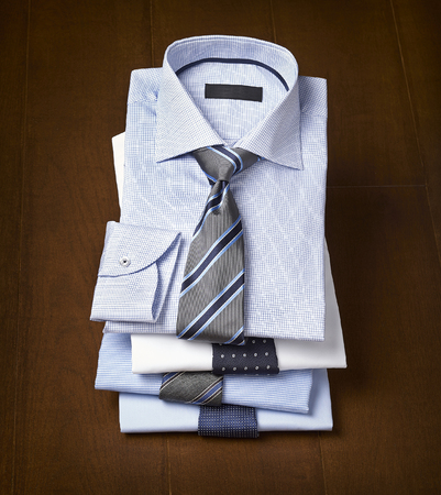 formal wear clothing: beautifull mens shirt on a wooden background