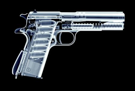 Xray beeld van pistool geïsoleerd op een zwarte achtergrond
