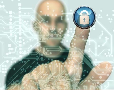 lock  futuristic: man pressing virtual computer screen with padlock.