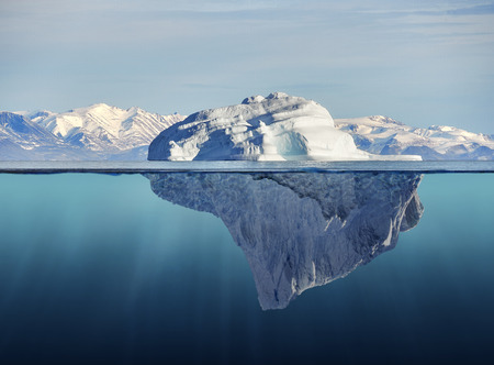 polar environment: iceberg with above and underwater view taken in greenland
