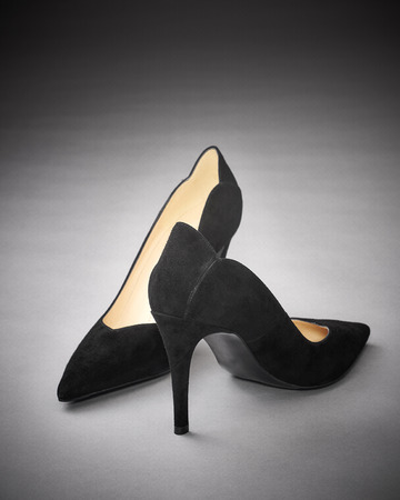 female pump shoe on gray background Stock Photo