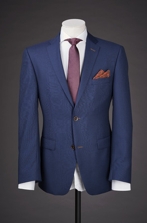 tailored: men business suit on grey background. Stock Photo