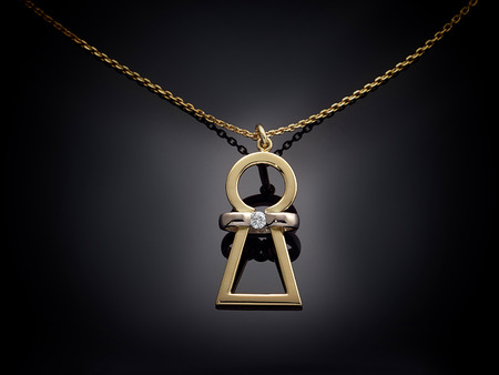 diamond shaped: Golden necklace with gemstone isolated on black background.