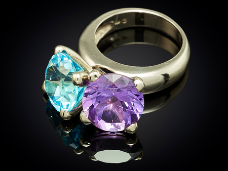 silver ring with gemstone isolated on black background. Stock Photo