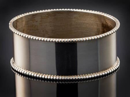 napkin ring: beautiful silver napkin ring on black background.