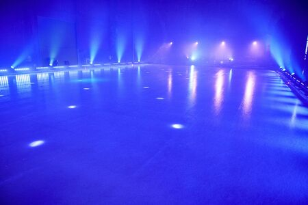 winter dance: ice floor with stage spotlights for ice dancing. Stock Photo