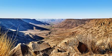 desert of namib with orange sand dunes.