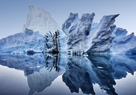 iceberg floating in greenland fjord.