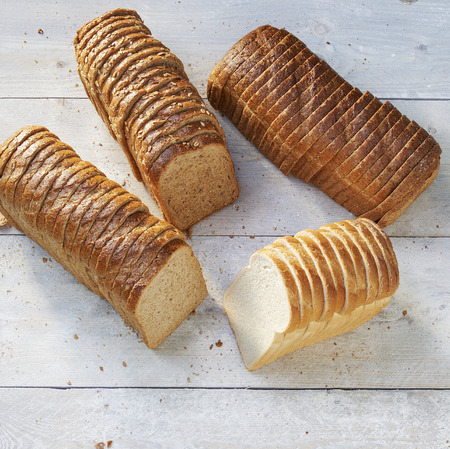 loaf of bread white and brown on wood. Imagens