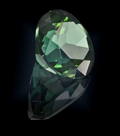 tourmaline gem stone isolated on black background. Imagens