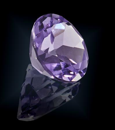 amethist gem stone isolated on black background.