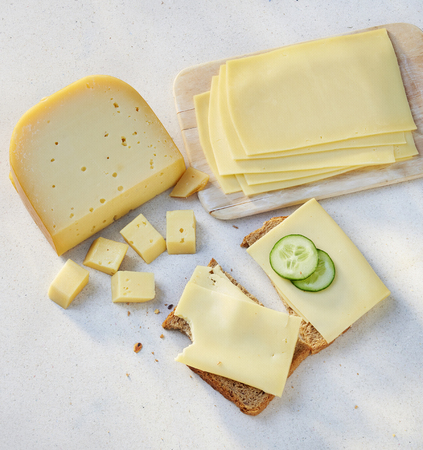 cheese pieces and slices on a slice of bread.