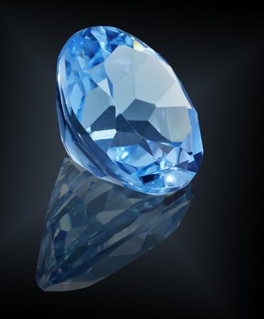 topaz swiss gem stone isolated on black background.