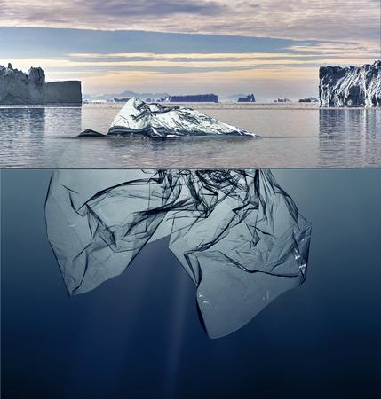 iceberg of garbage plastic floating in ocean with greenland background 版權商用圖片