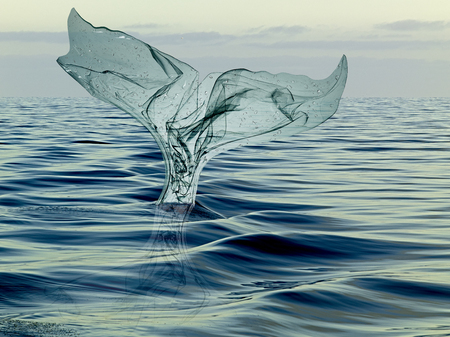 tail of a whale of garbage plastic floating in the ocean Imagens