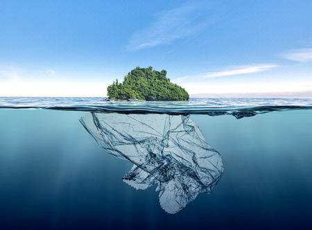 iceberg of garbage plastic with island floating in the ocean.