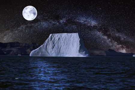 iceberg with starry night and a full moon.