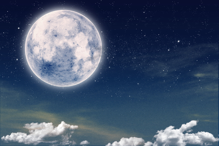 skyscape with starry night and a full moon. Imagens