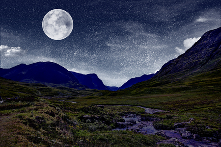 landscape with starry night and a full moon.