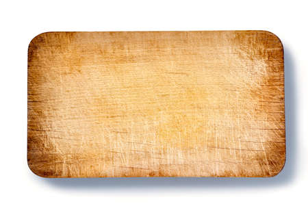 Top view of used brown wooden cutting board on white background