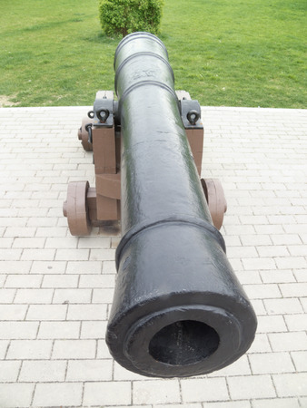 barrel tile: The old cannon, stands in the walking park Stock Photo