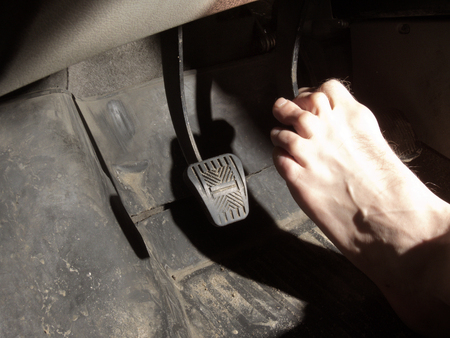 hairy: barefoot foot on brake pedal