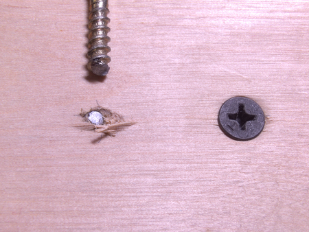 tightening: the Copper-plated screw, accidentally broken when tightening Stock Photo