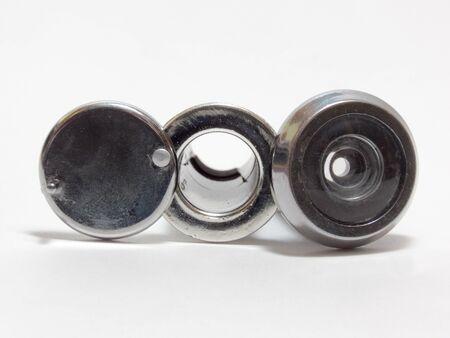 peephole: Plastic silver door peephole viewer Stock Photo