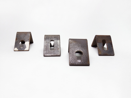 four corners: Four metal corners for hanging cabinets, with round and oval holes for mounting