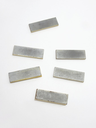 sideboard: The return plate of magnet catch for glass door sideboard. Metal in a protective plastic corner. Vintage