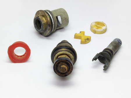 internals: Parts of disassembled ceramic and rubber shut-off valves for the plumbing. A very detailed view Stock Photo