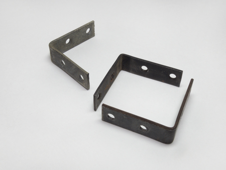 mounting holes: The metal mounting brackets with holes for screws. Closeup Stock Photo