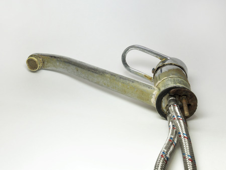 dismounted: Mixer with pipes. Liner of the flexible plumbing pipes. details of the connection