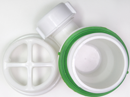 sink drain: Plastic strainer for drain for hole of the sink. A fragment of the drain system