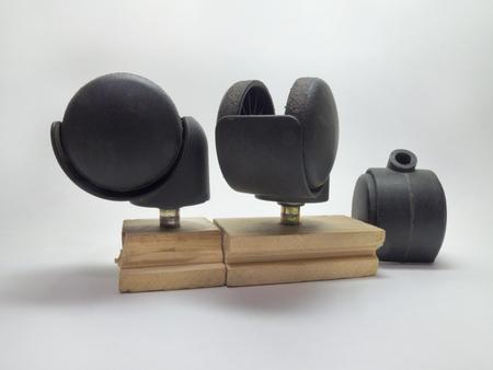 unattached: Three black castors for furniture
