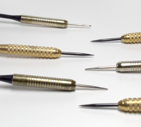 Darts sharp steel needles, brass or stainless barrels closeup. Square frame