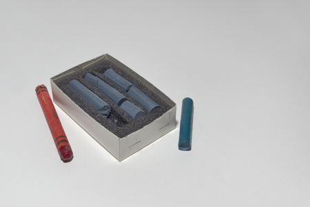pastel crayon on sponge in box and old colored wax chalks around