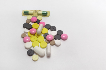 scattering of colorful pills and capsules