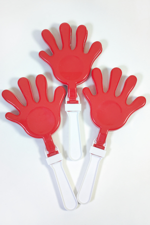 toy-rattle for applaud in form of palm, with white handles
