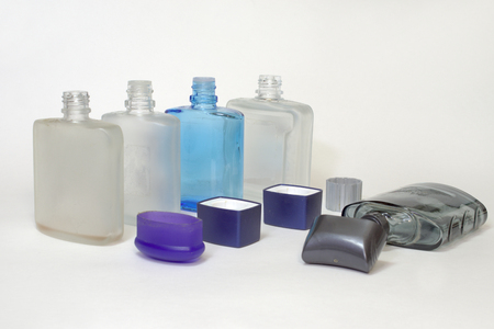 empty bottles of lotions after shave with open caps in a row