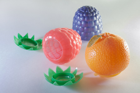 set of childrens toy containers in the form of berries and fruits, raspberries, blackberries and orange