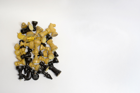 neat pile of blacks and whites chess pieces Stock Photo