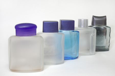 empty bottles of lotions after shave in a row with closed caps Imagens