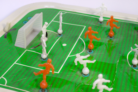 Table football, in which toy players mounted on springs. A little-known variant of the game. A  fragment of the playing field near the gate with goalkeeper