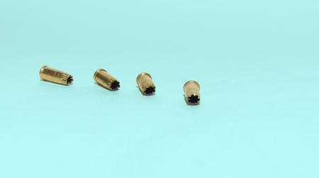 nail gun blank shots in row on cyan background