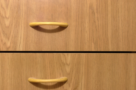 wooden drawers with graceful slim pull handles. Furniture for anteroom. bow-type. arcs of shadows Stock fotó